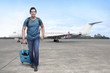 Traveler asian man get off the plane with suitcase