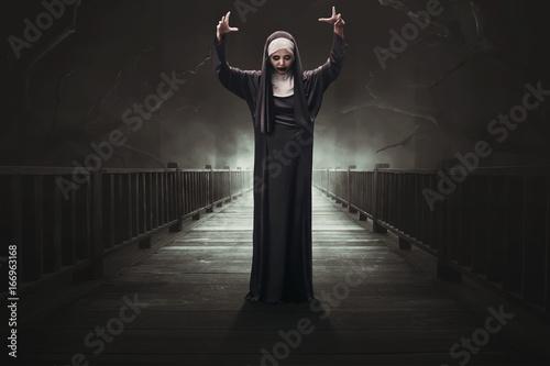 Tablou Canvas Scary asian woman devil nun
