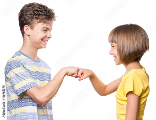 Friendship teen boy and girl are banging their fists portrait of friendship teen boy and girl are banging their fists portrait of happy brother and sister m4hsunfo