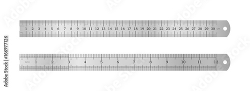 Fotografie, Obraz Realistic metal ruler of 30 centimeters and a metal ruler of 12 inches