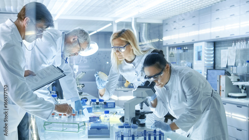 Team of Medical Research Scientists Work on a New Generation Disease Cure Canvas Print