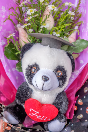 Stickers pour portes Panda Bouquet of teddy bear and flowers wrapped in plastic for present