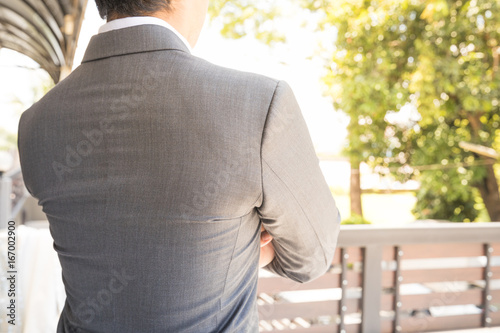 businessman stand Excitement and turn back he has smart pose and he is Business Canvas Print