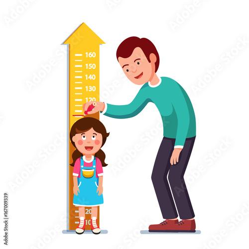 Fotografía  Teacher or father measuring girl kid height