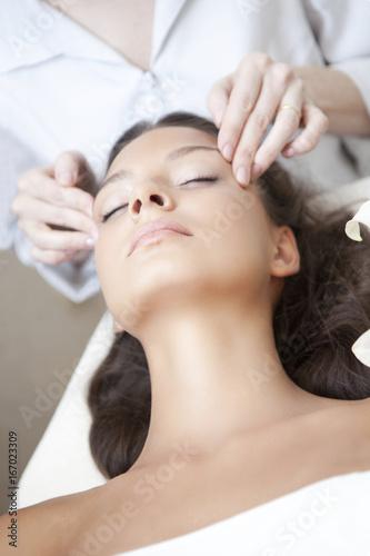 Fotografie, Obraz  Spa salon: Young Beautiful Woman Having Facial Massage