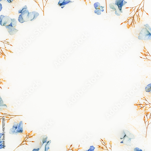Foto op Canvas Bloemen Floral background. Floral round frame made of blue flowers on white background, Flat lay, Top view.