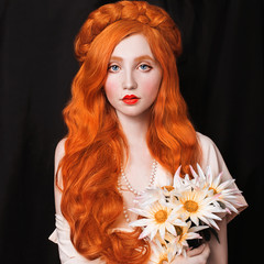 Naklejka A woman with pale skin and long red hair in a light vintage dress and a pearl necklace. Girl with red lips and flowers in hands on a black background. Hair care