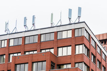 Cell Phone Towers On Brick Building In City