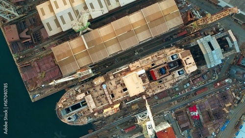 Papel de parede Aerial top down view of unfinished ship at the shipyard