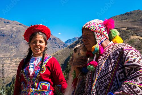 Staande foto Lama Native Peruvian group with their Llama in Sacred Valley, Cusco, Peru