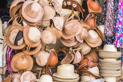 Fényképezés Leather and straw hats in craft store Brazil