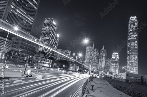 Night traffic and skyline of Hong Kong city Poster