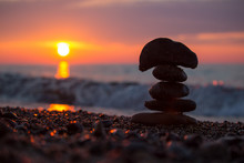 A Rock Cairn Stacked On The Be...