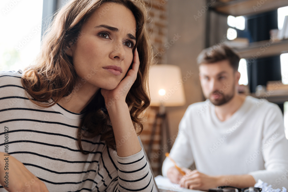 Fototapeta Depressed cheerless woman thinking about her problems