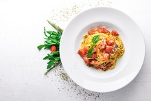 Pasta Tomatoes. Italian Traditional Food. On A Wooden Background. Top View. Free Space For Your Text.