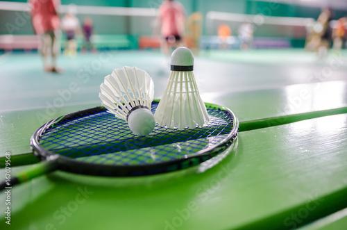 Photo shuttlecock on badminton racket.