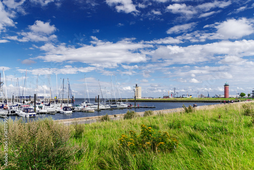 waterfront in Cuxhaven, Germany with lighthouse in background