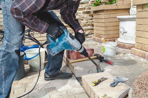 Fotografie, Obraz  Construction Hammer destroying brickwork