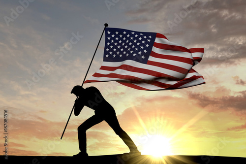 United States flag being pushed into the ground by a male silhouette Wallpaper Mural