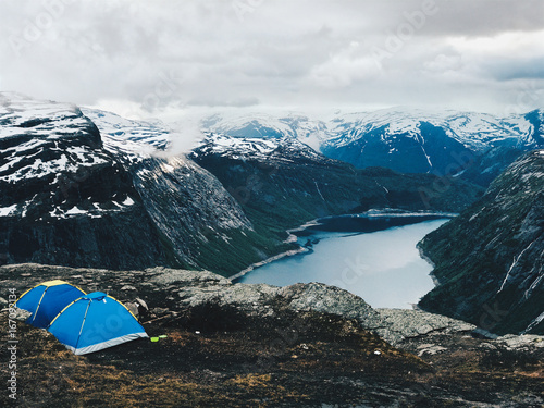 Poster Scandinavië Two blue tents stand before a gorgeous mountain view