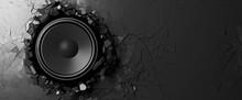 Loudspeaker On A Black Wall Ba...
