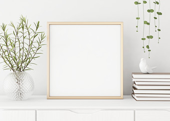 Interior poster mock up with square metal frame and plants in vase on white wall background. 3D rendering.