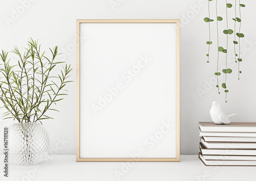 Fotografia  Interior poster mock up with vertical metal frame and plants in vase on white wall background