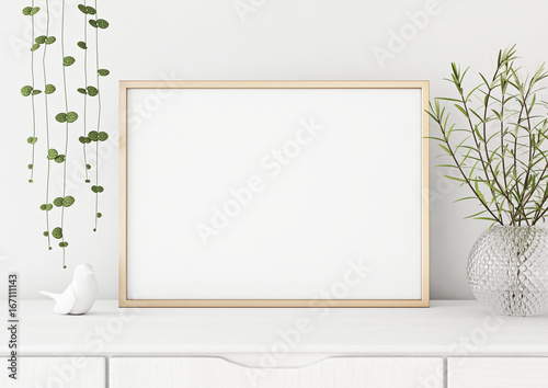 Fotografiet  Interior poster mock up with horizontal metal frame and plants in vase on white wall background