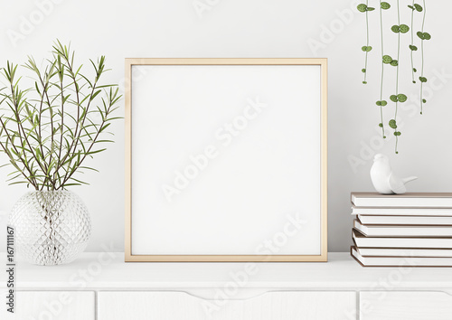 Fotografía  Interior poster mock up with square metal frame and plants in vase on white wall background