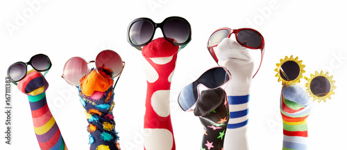 Sock puppets with glasses against white background