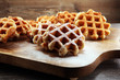canvas print picture - Traditional belgian waffles on brown wooden board