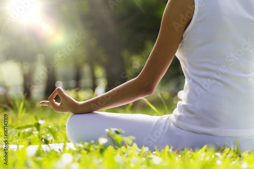 Vászonkép Young woman sitting in lotus position