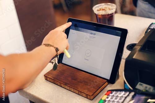 Closeup shot of young caucasian female woman cashier hands Canvas Print