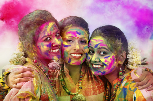 Portrait Of Three Young Indian Women With Colored Face During Holi Color festiva Canvas Print