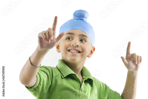 Photo  A Sikh boy dancing
