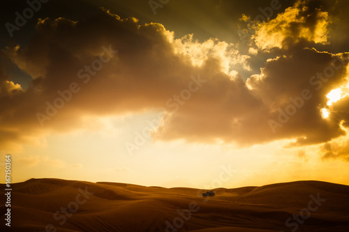 Poster Oranje Scenic View Of Dramatic Sky Over Desert Landscape With Car