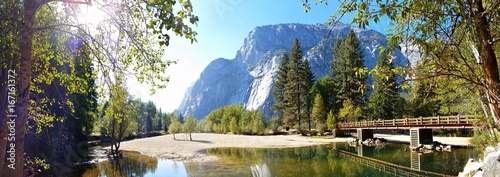 Wall Murals Natural Park Panoramic image of Swinging Bridge at Yosemite National Park, California, USA