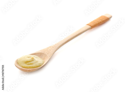Spoon with delicious mustard sauce on white background