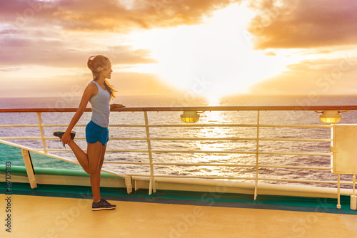 1ab54eea710 Fitness runner woman stretching leg warm-up before exercise on outdoor deck  of cruise ship boat. Woman enjoying Caribbean ... See More