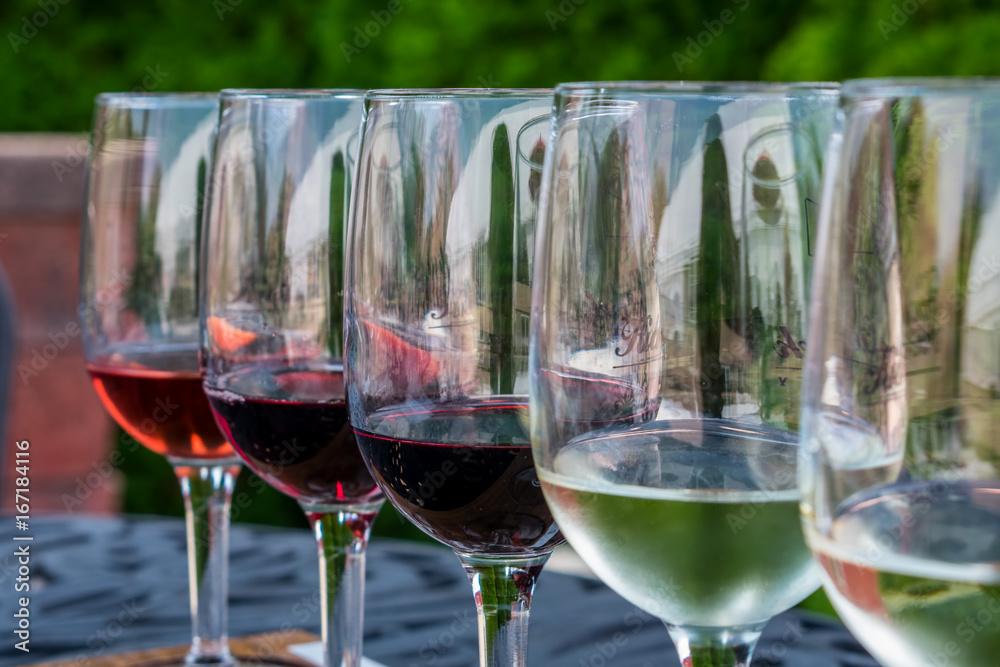 Fototapeta Glasses lined up for a wine tasting