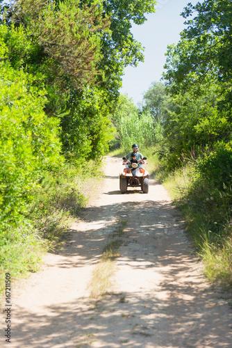 Driving quad bike on a dirt road