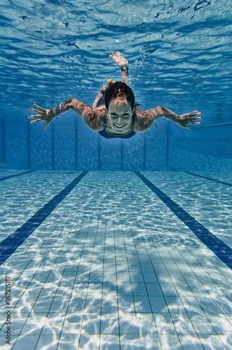 Female smiling underwater