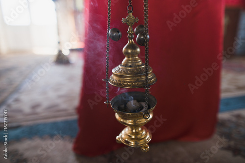 Valokuvatapetti Censer in the church in natural light