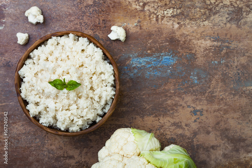Fotografie, Obraz  Cauliflower rice in a bowl. Top view, overhead, copy space