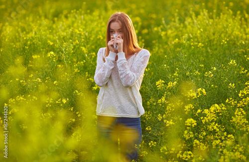 Photo  Pollen allergy, girl sneezing