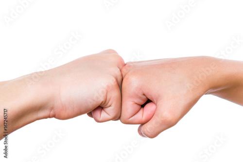 Close up hands of boy and girl are banging their fists fist bump close up hands of boy and girl are banging their fists fist bump isolated m4hsunfo