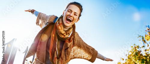 Obraz Happy young woman having fun time in autumn outdoors - fototapety do salonu