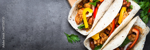 Fotografie, Obraz  Mexican taco with meat beans and vegetables. Long banner format.