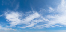 Panoramic Blue Sky Background With White Clouds On A Sunny Day
