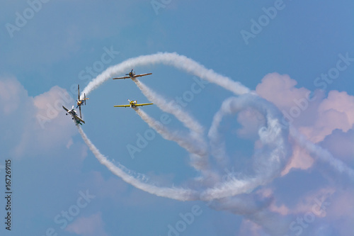 A Flying Squadron Executing Showing True Mastery at the Airshow Fototapet
